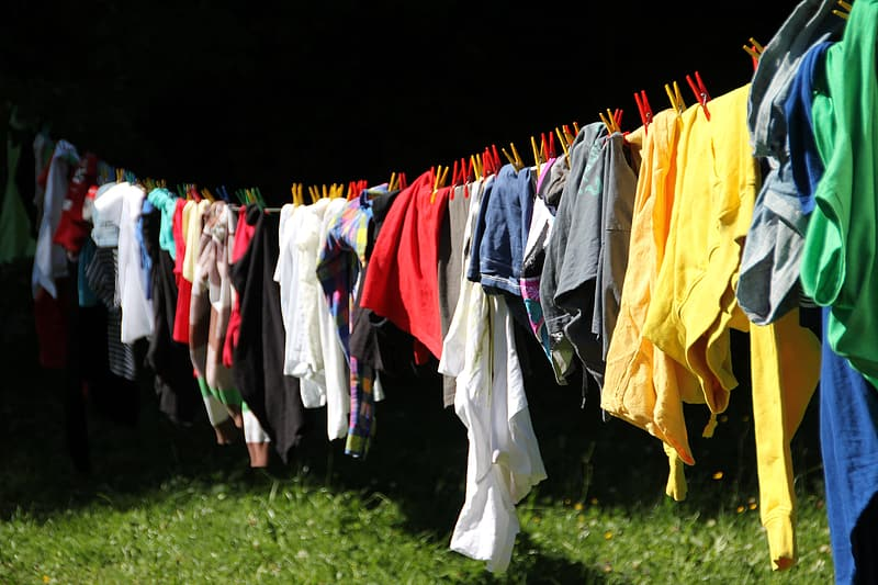 Photo of multicolored clothes hanged during daytime