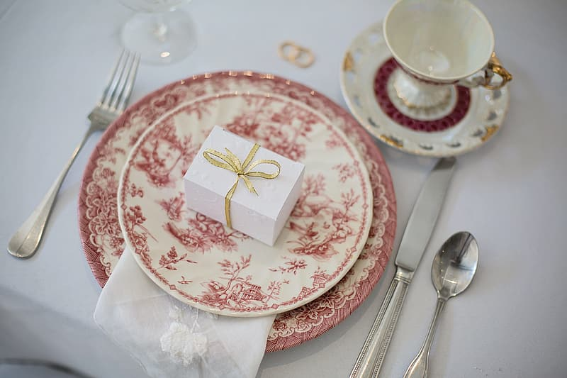 Round white and red floral ceramic dinnerware set