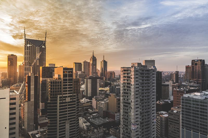 Bird's eye photography of high rise buildings during golden hour