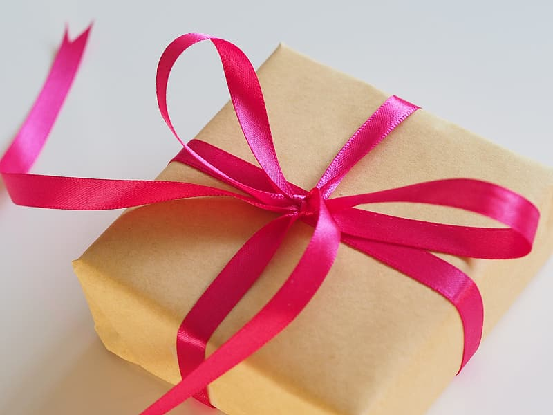 Photo of square yellow box with pink ribbon