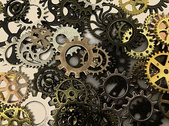 Photography of black, gray, and brown steel gears