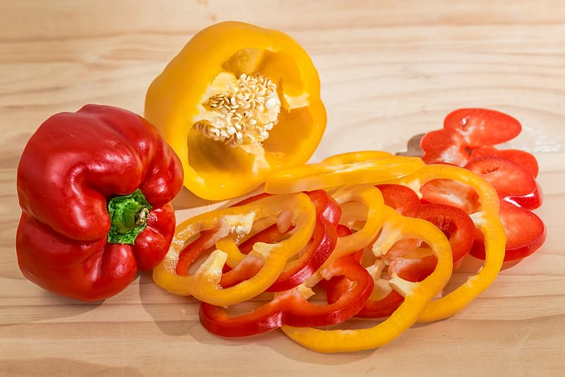 Bell pepper slices and whole red bell pepper