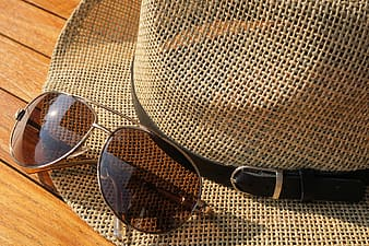 Photo of sunglasses on top of hat