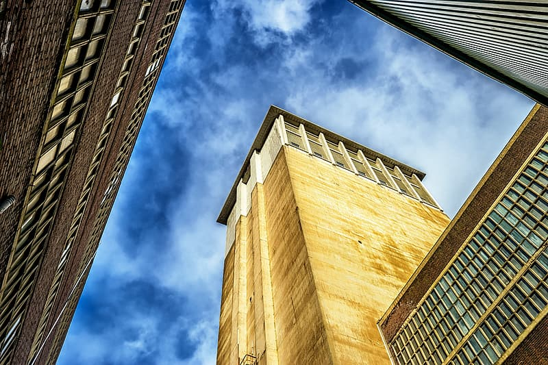 Low angle photo of brown and white concrete building