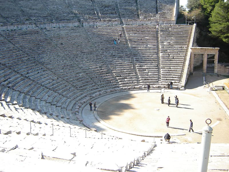 Group of people stand on half-circle coliseum