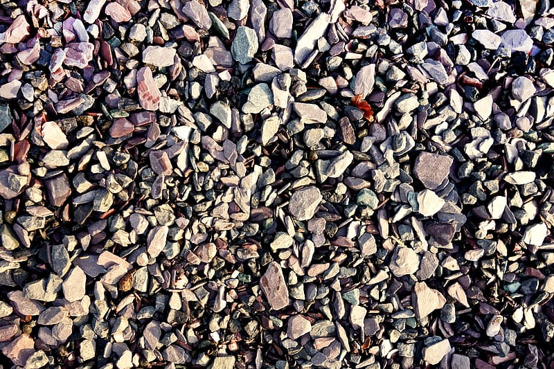 Gray and brown stones on ground