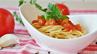 Pasta dish on white ceramic bowl