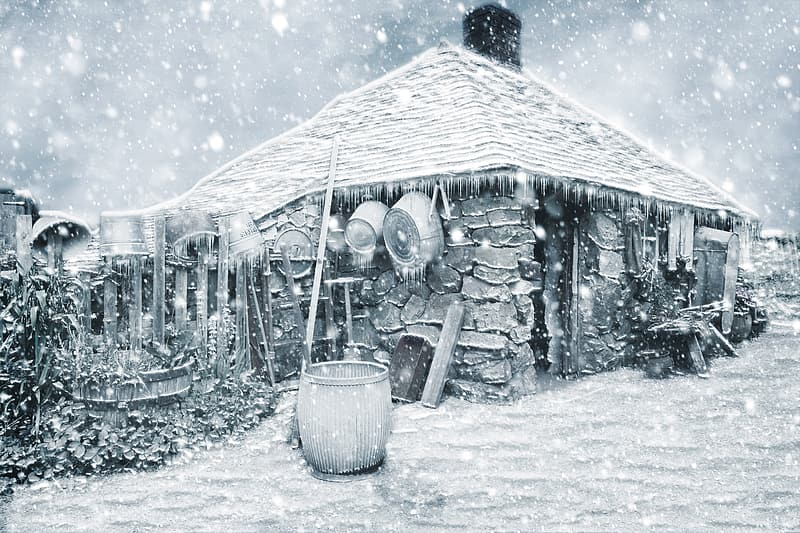 Drum beside snow covered house