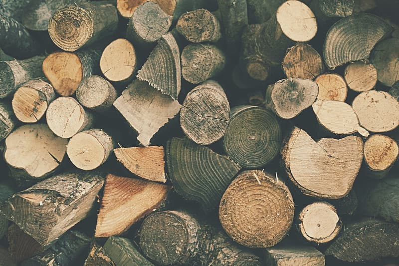 Piled brown firewood lot