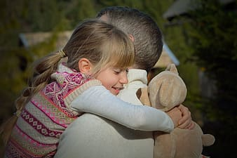 Man and child hugging each other