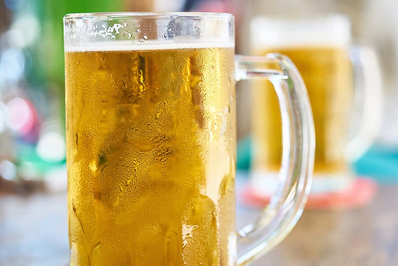 Clear glass mug filled with beer