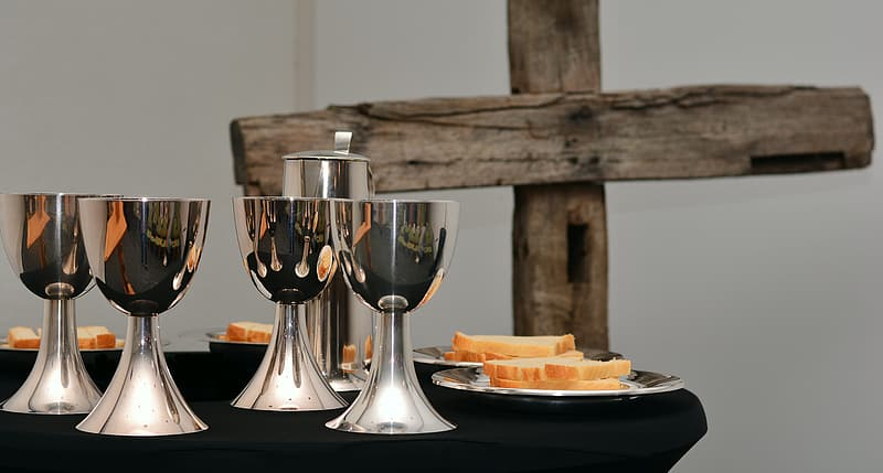Silver chalice on table
