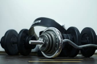 Photo of black and gray barbell and dumbbell