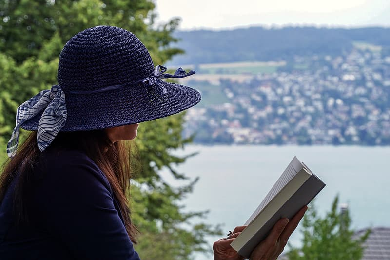 Woman in black jacket reading book
