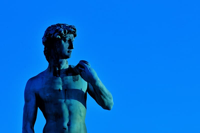 Statue of David on blue background