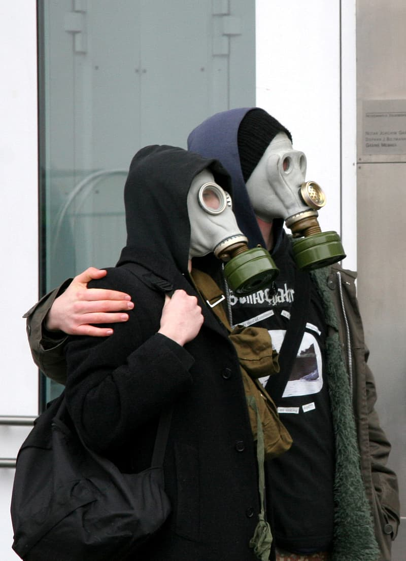 Two persons wearing gas masks