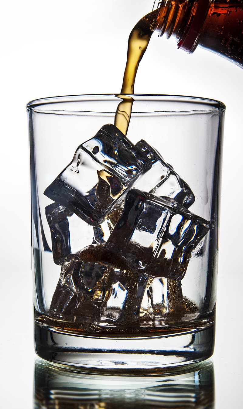 Clear glass cup with ice cubes