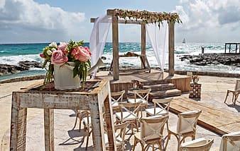 Organized chairs beside body of water
