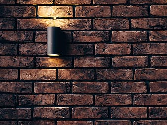 Brick wall with sconce