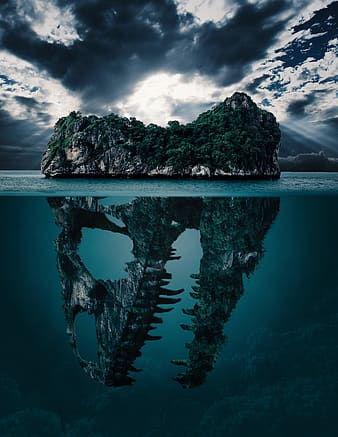 Green leaf trees with dinosaur skull island on body of water