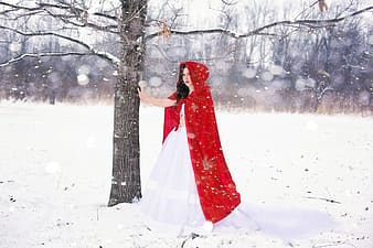 Photo of red riding hood on snowfield
