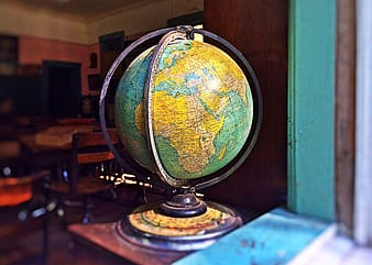 Blue and yellow desk globe inside room