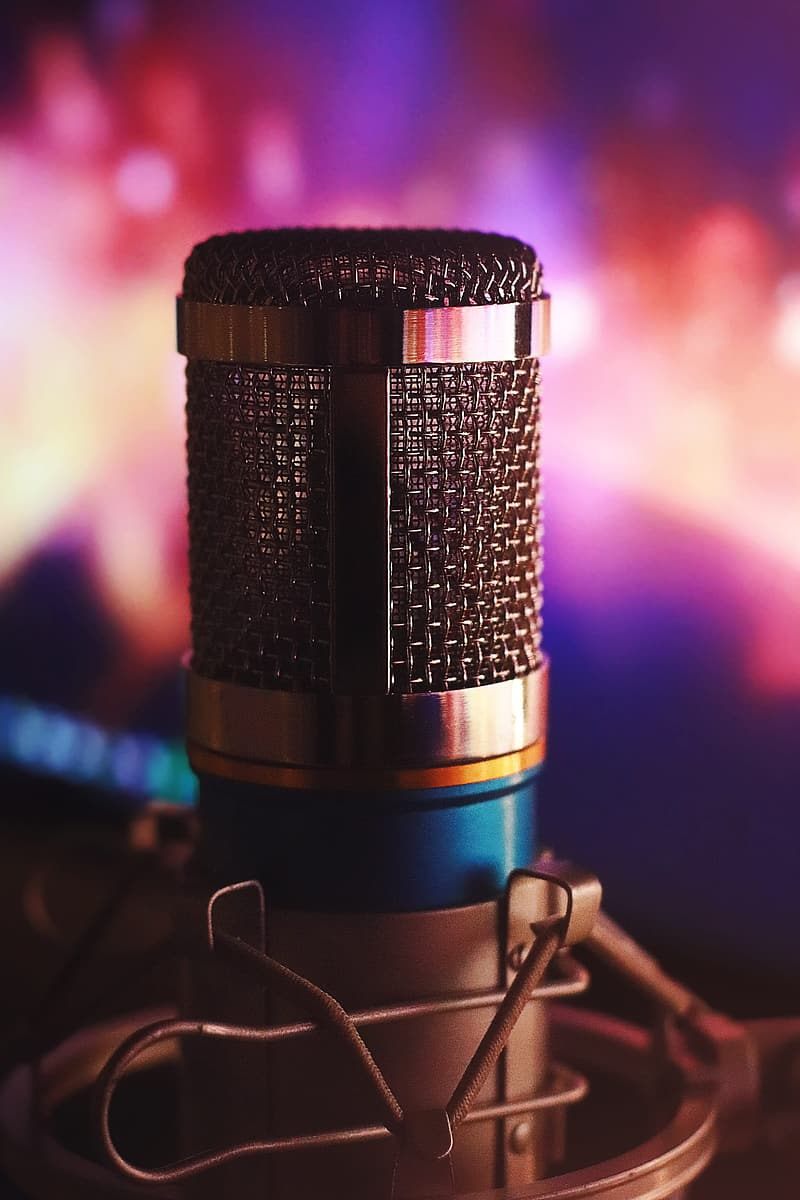 Black and silver microphone on black steel stand