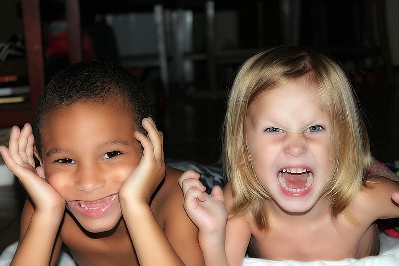 Photography of little girl with blonde hair and little boy with black hair