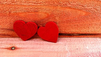 Photo of two red heart wooden decors