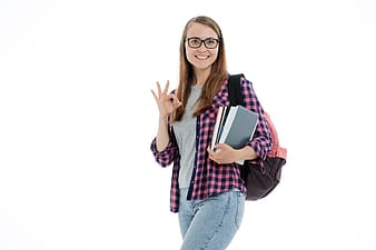 Woman in pink and white plaid dress shirt and blue denim jeans wearing black framed eyeglasses
