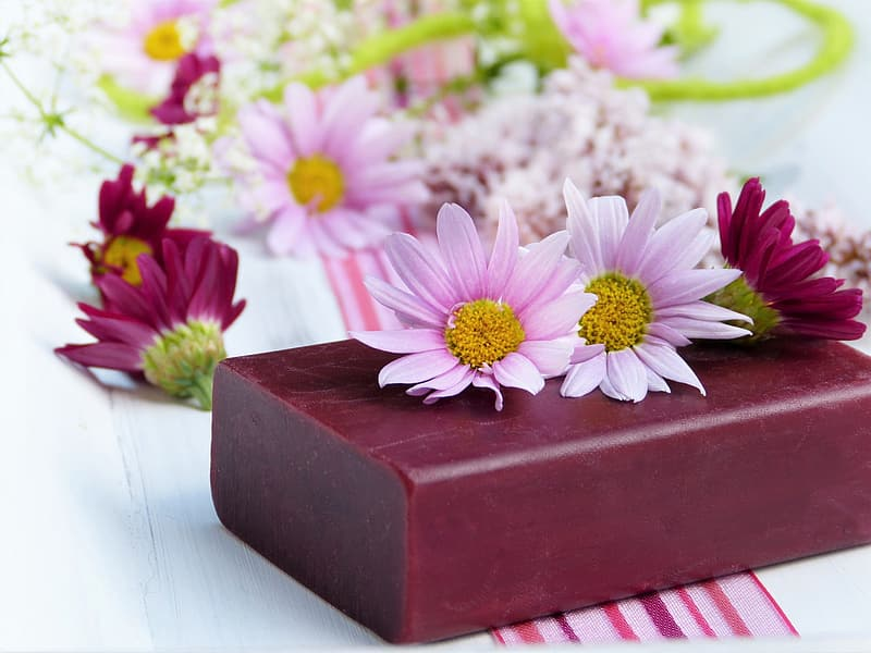 White and purple flowers on brown wooden box