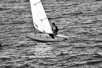 Person sitting on sailboat