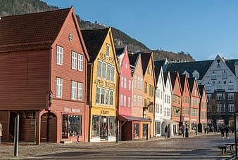Assorted-color wooden houses under bright sky