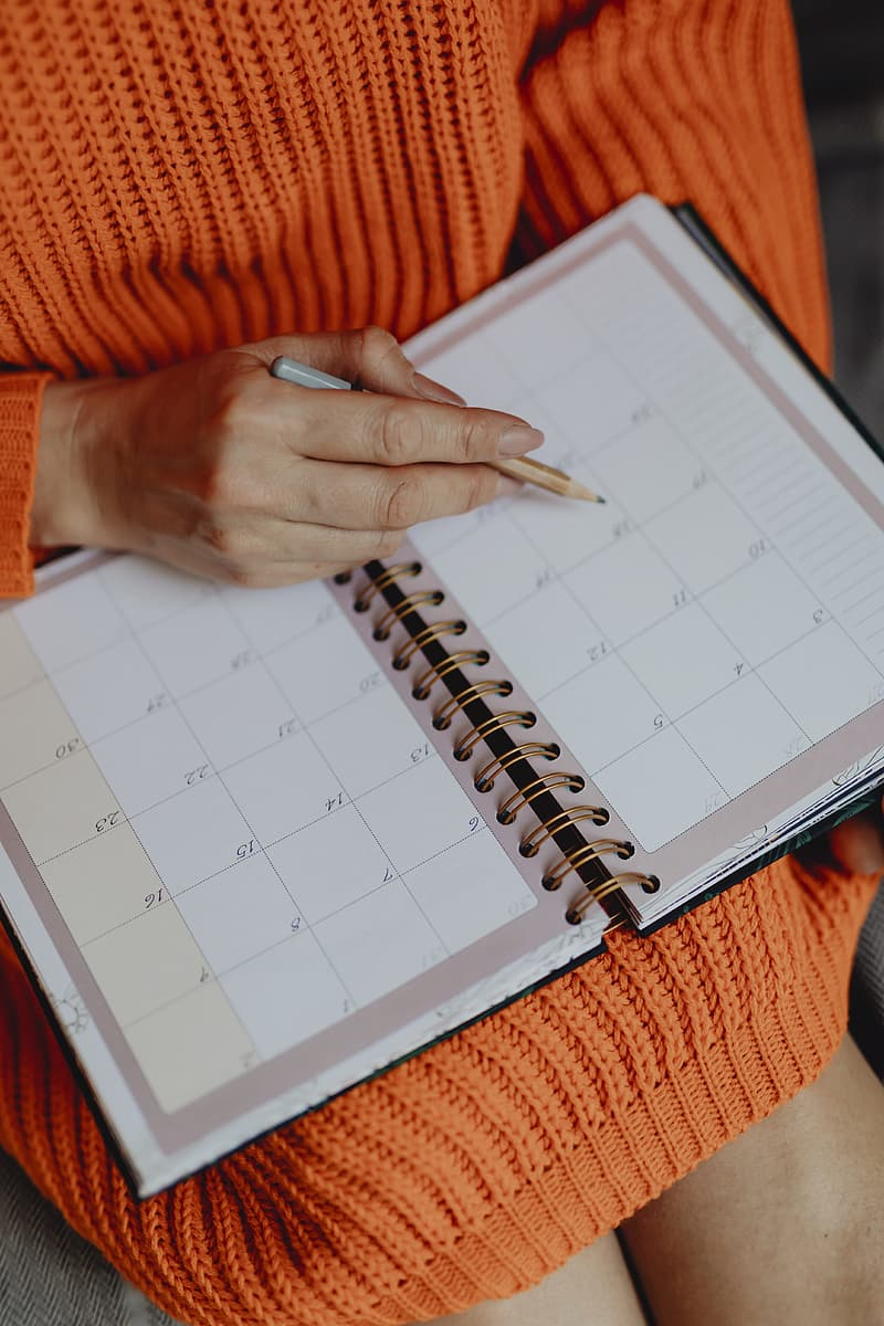 Person holding white ruled paper