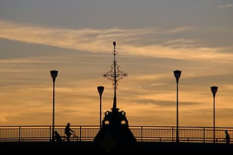 Silhouette of people sitting on bench during sunset