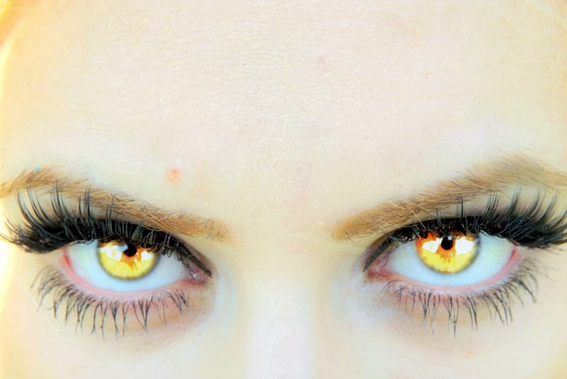 Person with yellow eyes