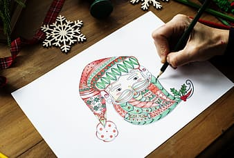 Person drawing Santa Claus head