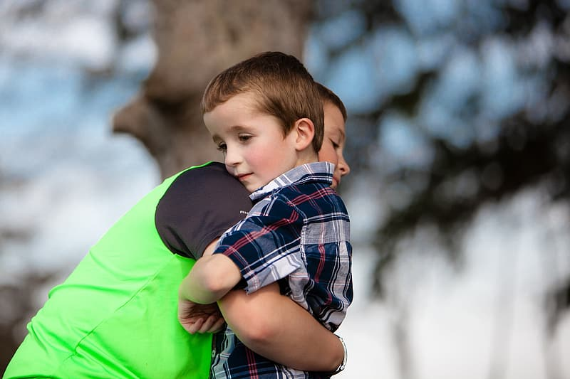 Two boys embracing