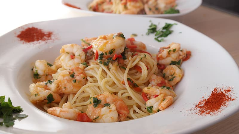 Spaghetti with shrimp served on plate