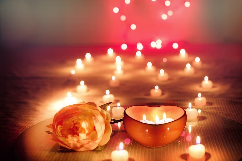 Depth of field photography of romantic candle arrangement