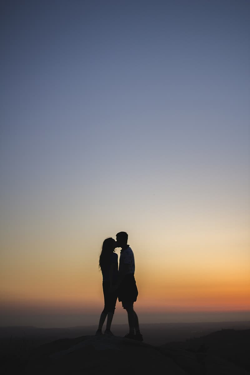 Silhouette of man and woman kissing photo