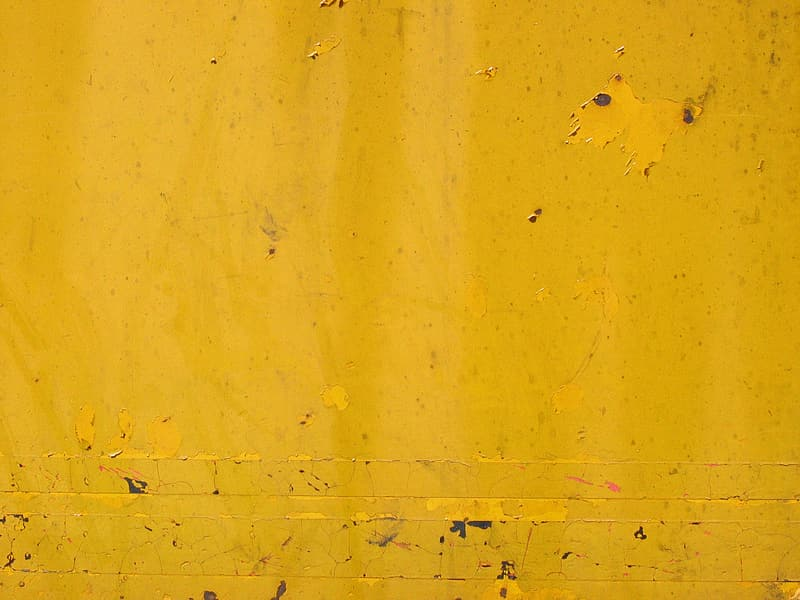 Yellow painted wall with hole
