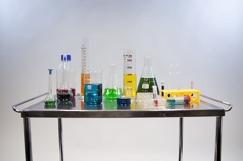 Clear glass bottles on table