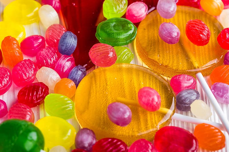 Assorted-color candy lot on white surface