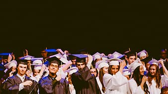 Group of people wearing graduation gowns