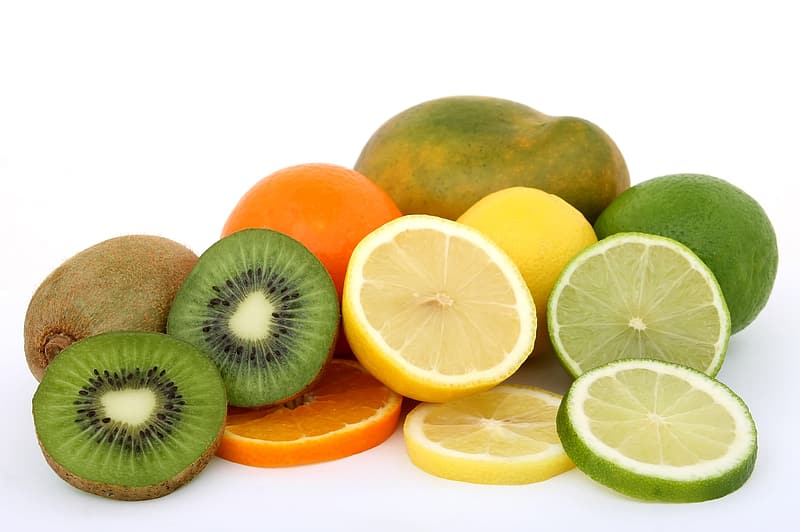 Sliced kiwi, orange, lemon, and green papaya fruits