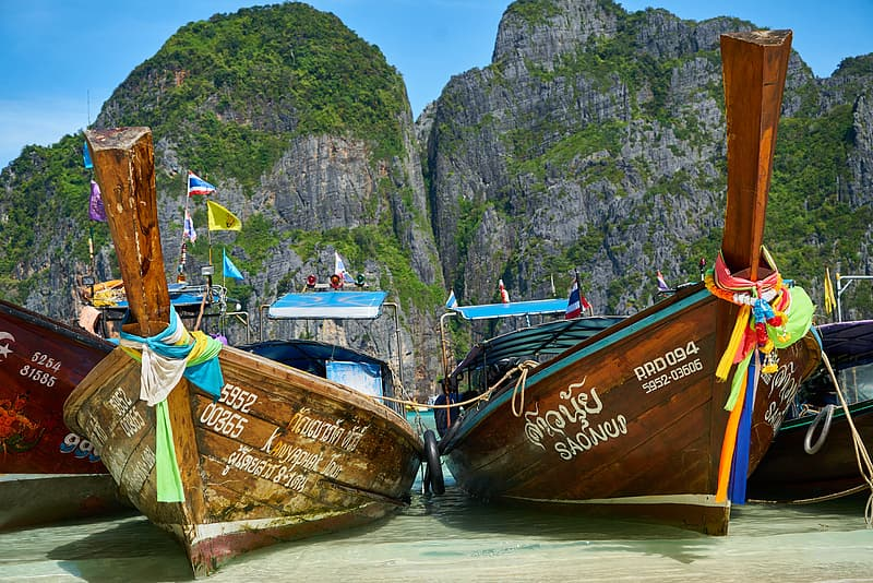 Two brown wooden boats