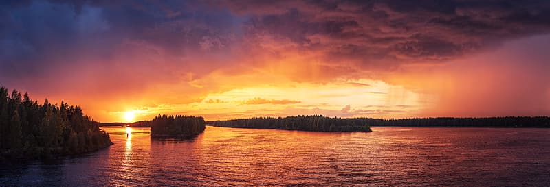 Panoramic photography of body of water during sunset