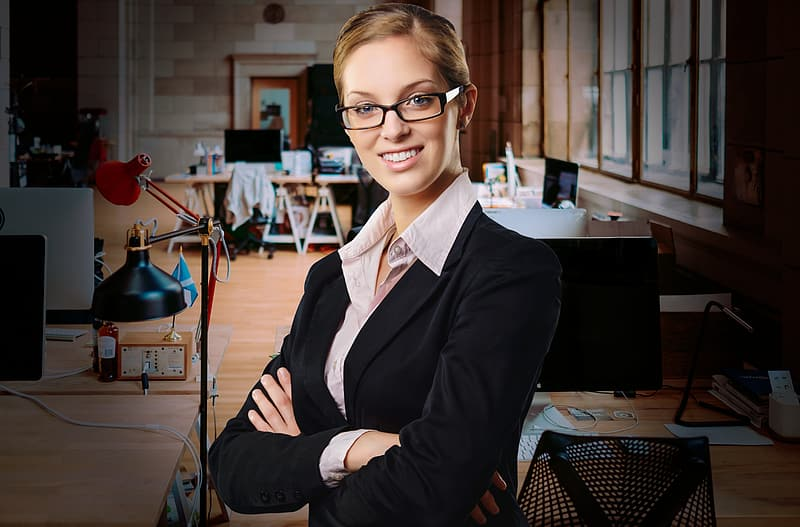 Woman in black blazer wearing eyeglasses