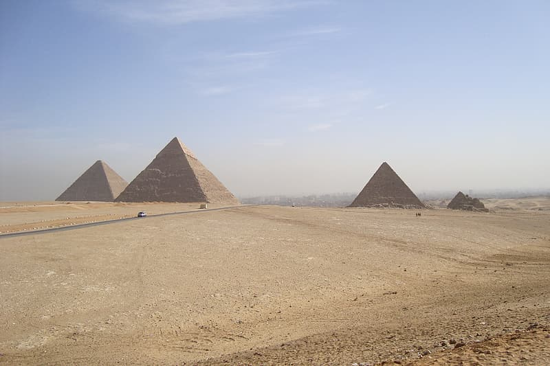 Three pyramids in the middle of desert